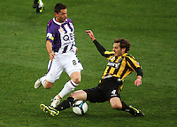 Phoenix' Jon McKain tackles Victor Sikora during the A-League football match between Wellington Phoenix and Perth Glory at Westpac Stadium, Wellington, New Zealand on Sunday, 16 August 2009. Photo: Dave Lintott / lintottphoto.co.nz