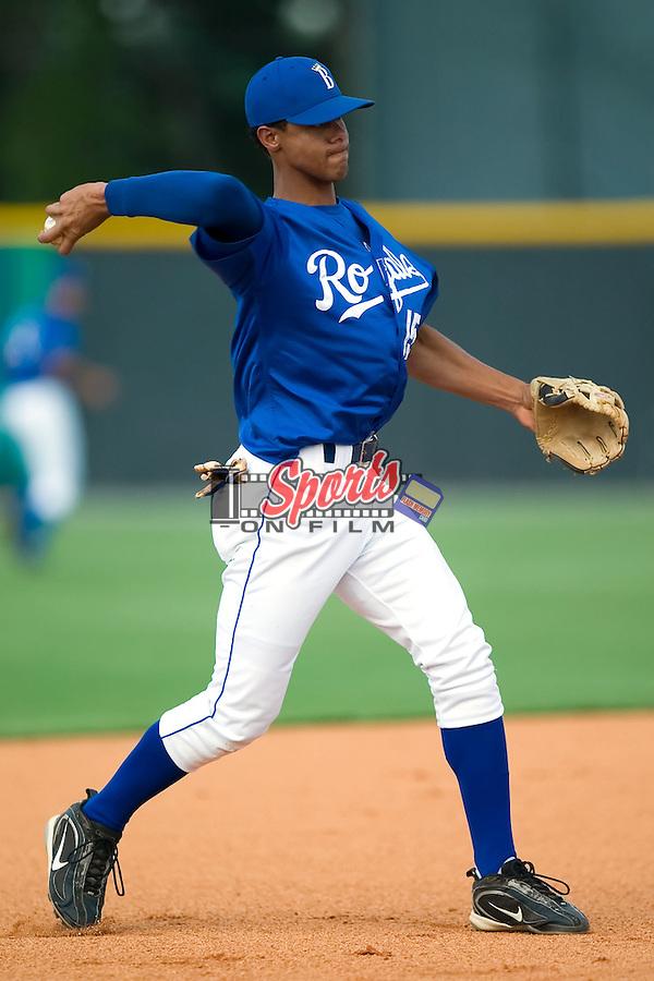 Burlington third baseman Antonio Jimenez (15) makes a throw during batting practice at Burlington Athletic Park in Burlington, NC, Thursday, July 12, 2007.