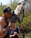 """Gregg and Susan Lopez of Huntington with """"Titania"""" a Thoroughbred horse with whom Gregg Lopez has bonded in Equine Therapy at the Stanhope Stables in West Hills on Monday September 3, 2007. Lopez suffers from a variety of ailments both physical and mental from the months he worked in recovery efforts at the World Trade Center Ground Zero. Photo by Jim Peppler."""