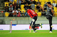 NZ's Colin de Grandhomme watches as James Vince is run out by Kane Williamson during the International Twenty20 cricket match between the NZ Black Caps and England at Westpac Stadium in Wellington, New Zealand on Tuesday, 13 February 2018. Photo: Dave Lintott / lintottphoto.co.nz