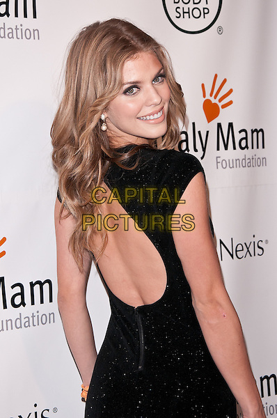 Annalynne McCord.Somaly Mam Gala 2011, New York City, NY, USA..October 20th, 2011.half length dress black back behind rear looking over shoulder backless .CAP/ADM/CS.©Christopher Smith/AdMedia/Capital Pictures.