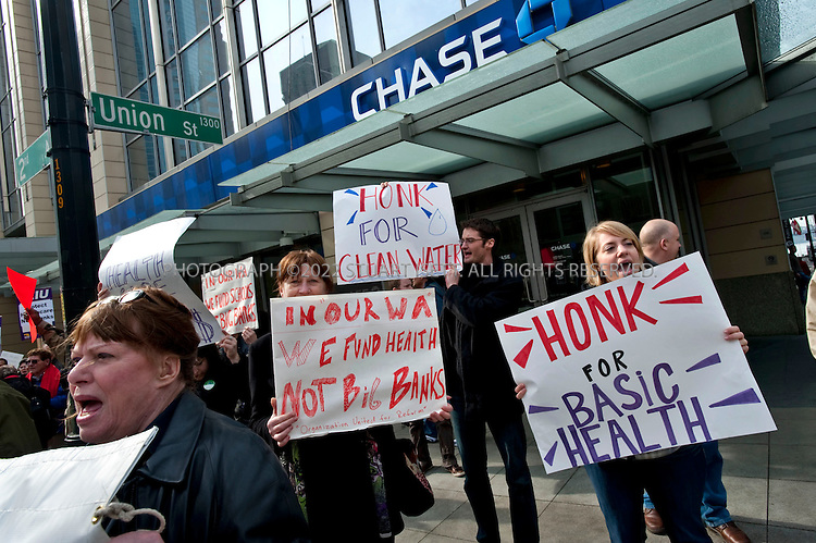 3/15/2010--Seattle, WA, USA..Members of the AFL-CIO, Service Employees International Union (SEIU), AARP and other activists from 'Fuse Washington' gather outside the Chase Bank branch at 2nd Ave and Union in downtown Seattle. The bank is in the former Washington Mutual (WAMU) building. WAMU collapsed in 2008 and was bought out by Chase. ..Protesters support a Washington State bill that would end a tax exemption for the largest banks that allows them not to pay taxes on interest earned from first mortgages. The exemption was made 40 years ago to help Washington-based national banks compete for mortgage business with out-of-state rivals, but the banking market has changed. The change would bring in an estimated $67 million more in tax revenues for the state...©2010 Stuart Isett. All rights reserved.