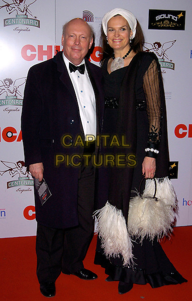 """SIR JULIAN FELLOWES & EMMA KITCHENER-FELLOWES.The """"Chicago"""" 10th anniversary afterparty, Sound bar & nightclub, London, England..December 5th, 2007.full length black coat blue headscarf white feathers white scarf sheer married husband wife.CAP/CAN.©Can Nguyen/Capital Pictures"""