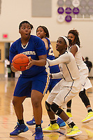 Pflugerville center Alexis Bryant looks to pass against Cedar Ridge Friday.  The Panthers beat the Raiders 70-66 at Cedar Ridge.  (LOURDES M SHOAF for Round Rock Leader.)