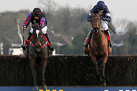 Race winner Alasi ridden by Dominic Elsworth (R) jumps alongside Champion Court ridden by Alain Cawley in the Kempton.co.uk Graduation Chase - Horse Racing at Kempton Park Racecourse