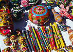 Colourful lacquered products on display on table at market, San Miguel de Allende, Mexico