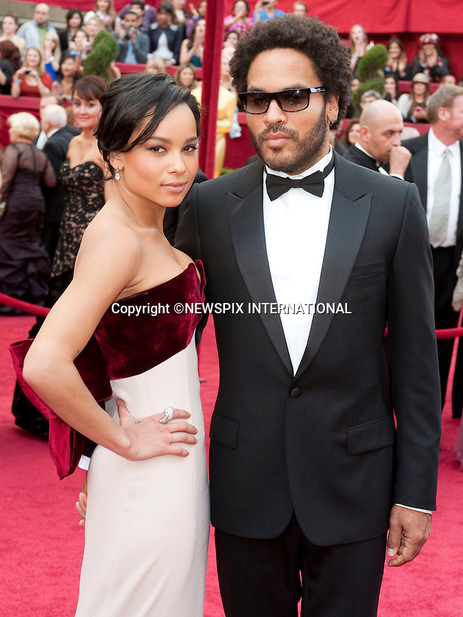 "Lenny Kravitz and Zoe Kravitz.OSCARS 2010 RED CARPET ARRIVALS.The 82nd Academy Awards  arrivals took place under a transparent tent to keep the red carpet dry from the pending rain_ Kodak Theatre, Hollywood, Los Angeles_07/03/2009.Mandatory Photo Credit: ©Dias/Newspix International..**ALL FEES PAYABLE TO: ""NEWSPIX INTERNATIONAL""**..PHOTO CREDIT MANDATORY!!: NEWSPIX INTERNATIONAL(Failure to credit will incur a surcharge of 100% of reproduction fees)..IMMEDIATE CONFIRMATION OF USAGE REQUIRED:.Newspix International, 31 Chinnery Hill, Bishop's Stortford, ENGLAND CM23 3PS.Tel:+441279 324672  ; Fax: +441279656877.Mobile:  0777568 1153.e-mail: info@newspixinternational.co.uk"