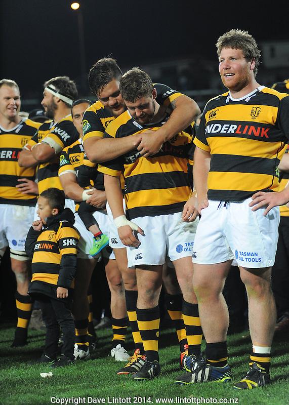 Angus Ta'avao hugs Rhys Marshall after winning the ITM Cup rugby premiership final between Taranaki and Tasman Makos at Yarrow Stadium, New Plymouth, New Zealand on Saturday, 25 October 2014. Photo: Dave Lintott / lintottphoto.co.nz