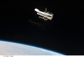 In Earth Orbit - May 19, 2009 -- An STS-125 crew member aboard the Space Shuttle Atlantis captured this still image of the Hubble Space Telescope as the two spacecraft continue their relative separation on May 19, 2009, after having been linked together for the better part of a week. During the week five spacewalks were performed to complete the final servicing mission for the orbital observatory..Credit: NASA via CNP