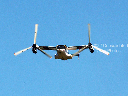 The XV-15 tilt rotor aircraft seems to be flying directly towards the camera during its last flight as NASA and the U.S. Army transferred the vehicle to the National Air and Space Museum's new Steven F. Udvar-Hazy Center near Washington Dulles International Airport in Herndon, Virginia on September 16, 2003.  Tilt rotors are a unique type of aircraft that possess the take-off, hover and landing capabilities of a conventional helicopter with the range and speed of a turboprop aircraft.  Tilt rotor flight research began in the 1950s with the Bell XV-3 convertiplane.  NASA's Ames Research Center, Moffett Field, Calif., in partnership with the U.S. Army, developed design specifications for a new aircraft to demonstrate the viability of the tilt rotor concept.  After extensive ground, wind tunnel and simulator tests at Ames, the first of two XV-15s, built by Bell Helicopter Textron, took its maiden flight on May 3, 1977.  The success of the XV-15 has led to the development of the V-22 Osprey and the world's first civil tilt rotor, the nine-passenger Bell Agusta 609, now under development and scheduled for deliveries in 2007.  The National Air and Space Museum, comprised of the Udvar-Hazy Center, which is scheduled to open to the public on December 15, 2003, and the museum's building on the National Mall, .will be the largest air-and-space-museum complex in the world. .Credit: Ron Sachs / CNP