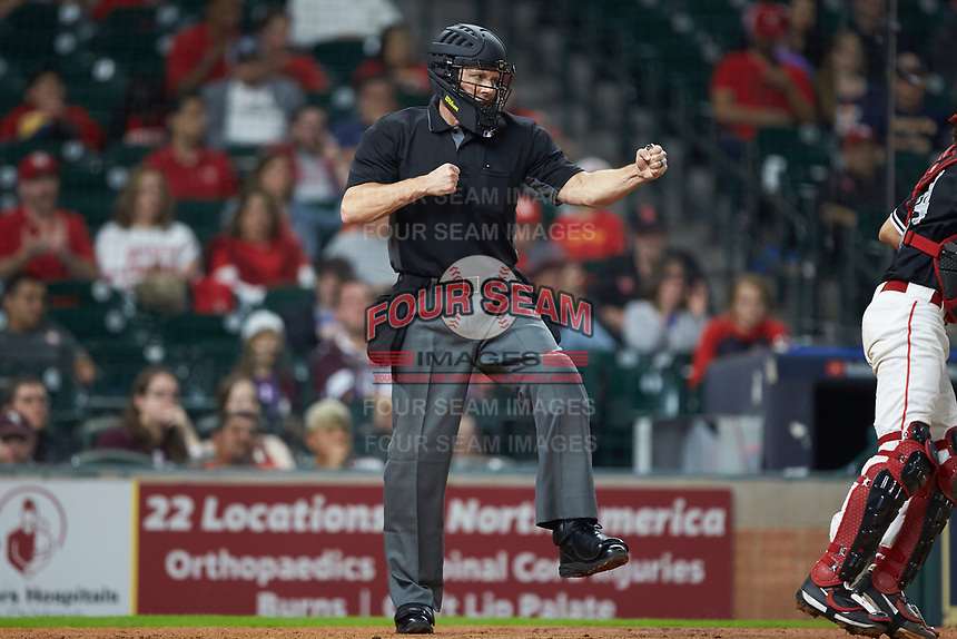 Home plate umpire Matt McKendry calls a batter out on strikes during the game between the Houston Cougars and the Mississippi State Bulldogs in game six of the 2018 Shriners Hospitals for Children College Classic at Minute Maid Park on March 3, 2018 in Houston, Texas. The Bulldogs defeated the Cougars 3-2 in 12 innings. (Brian Westerholt/Four Seam Images)