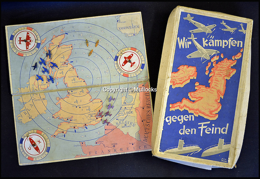 BNPS.co.uk (01202 558833)<br /> Pic: Mullocks/BNPS<br /> <br /> Who do you think your are kidding Mr Hitler...?<br /> <br /> A chilling WW2 boardgame for German children set around the invasion of Britain has emerged for sale - and the rules reveal the game could only end with a German victory...in Scarborough!<br /> <br /> The game, created at the start of the Second World War, was played by three children who used die-cast pieces of U-Boats, fighter planes and bomber aircraft to attack the UK in a triple-pronged attack.<br /> <br /> Auctioneers Mullocks are selling the unique survivor on March 1st.