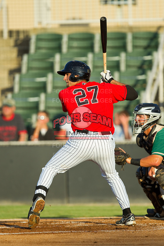 Nick Basto (27) of the Kannapolis Intimidators at bat against the Greensboro Grasshoppers at CMC-Northeast Stadium on July 15, 2013 in Kannapolis, North Carolina.  The Intimidators defeated the Grasshoppers 4-0.   (Brian Westerholt/Four Seam Images)