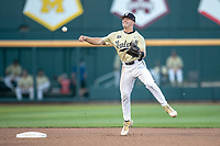 Vanderbilt Commodores shortstop Ethan Paul (10) makes a throw to first base against the Michigan Wolverines during Game 3 of the NCAA College World Series Finals on June 26, 2019 at TD Ameritrade Park in Omaha, Nebraska. Vanderbilt defeated Michigan 8-2 to win the National Championship. (Andrew Woolley/Four Seam Images)