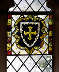 Medieval heraldic stained glass window, Badley church, Suffolk, England, UK