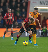 \Bournemouth's Ryan Fraser (left) is tackled by  Wolverhampton Wanderers' Matt Doherty (centre)<br /> <br /> Photographer David Horton/CameraSport<br /> <br /> The Premier League - Bournemouth v Wolverhampton Wanderers - Saturday 23rd November 2019 - Vitality Stadium - Bournemouth<br /> <br /> World Copyright © 2019 CameraSport. All rights reserved. 43 Linden Ave. Countesthorpe. Leicester. England. LE8 5PG - Tel: +44 (0) 116 277 4147 - admin@camerasport.com - www.camerasport.com