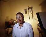 Loune Viaud, Director of Strategic Planning and Operations for a network of hospitals in Haiti that provides medical services to the poor. She was chosen as a human rights laureate by the Robert F. Kennedy Memorial Center for Human Rights in 2002. Loune is a procurement specialist for a health clinic in the highlands of Haiti. She is posing for a portrait at the Center for Haitian Studies in Little Haiti, Miami, Florida..Loune also has a drink at Cafe Italianne.