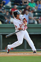 Third baseman Michael Chavis (11) of the Greenville Drive bats in a game against the Greensboro Grasshoppers on Thursday, August 27, 2015, at Fluor Field at the West End in Greenville, South Carolina. Chavis was a first-round pick of the Boston Red Sox in the 2014 First-Year Player Draft. Greenville won, 10-2. (Tom Priddy/Four Seam Images)