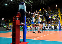BOGOTÁ-COLOMBIA, 08-01-2020: María Pérez de Venezuela, remata el balón a Victoria Mayer y Blanca Farriol de Argentina, durante partido entre Argentina y Venezuela, en el Preolímpico Suramericano de Voleibol, clasificatorio a los Juegos Olímpicos Tokio 2020, jugado en el Coliseo del Salitre en la ciudad de Bogotá del 7 al 9 de enero de 2020. / Maria Perez from Venezuela, shoots the ball to Victoria Mayer and Blanca Farriol from Argentina, during a match between Venezuela and Argentina, in the South American Volleyball Pre-Olympic Championship, qualifier for the Tokyo 2020 Olympic Games, played in the Colosseum El Salitre in Bogota city, from January 7 to 9, 2020. Photo: VizzorImage / Luis Ramírez / Staff.