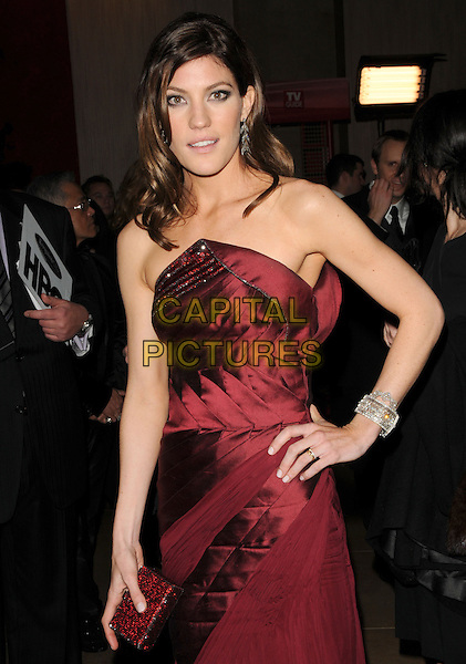 JENNIFER CARPENTER.Leaving the 67th Golden Globes held at The Beverly Hilton Hotel in Beverly Hills, California, USA..January 17th, 2010 .departures half length red maroon burgundy dress hand on hip strapless clutch bag.CAP/DVS.©Debbie VanStory/Capital Pictures