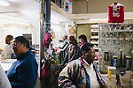 People line up at a bill pay station inside of Hall's Dry Goods on Main Street in Greensboro, Alabama, on March 1, 2013. Disability payments are made to those who receive them on the first of the month and Main Street becomes much more busy at this time.