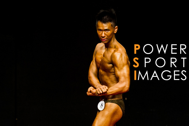 A bodybuilder competes in the Men's Youth Bodybuilding (below 21 year-old) category during the 2016 Hong Kong Bodybuilding Championships on 12 June 2016 at Queen Elizabeth Stadium, Hong Kong, China. Photo by Lucas Schifres / Power Sport Images