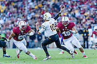 STANFORD, CA - SEPTEMBER 22, 2013: Ben Gardner pressures the quarterback during Stanford's game against Arizona State. The Cardinal defeated the Sun Devils 42-28.