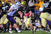 18 October 08: Colorado quarterback Tyler Hansen (9) rushes by Kansas State linebacker Alex Hrebec (47). The Colorado Buffaloes defeated the Kansas State Wildcats 14-13 at Folsom Field in Boulder, Colorado.