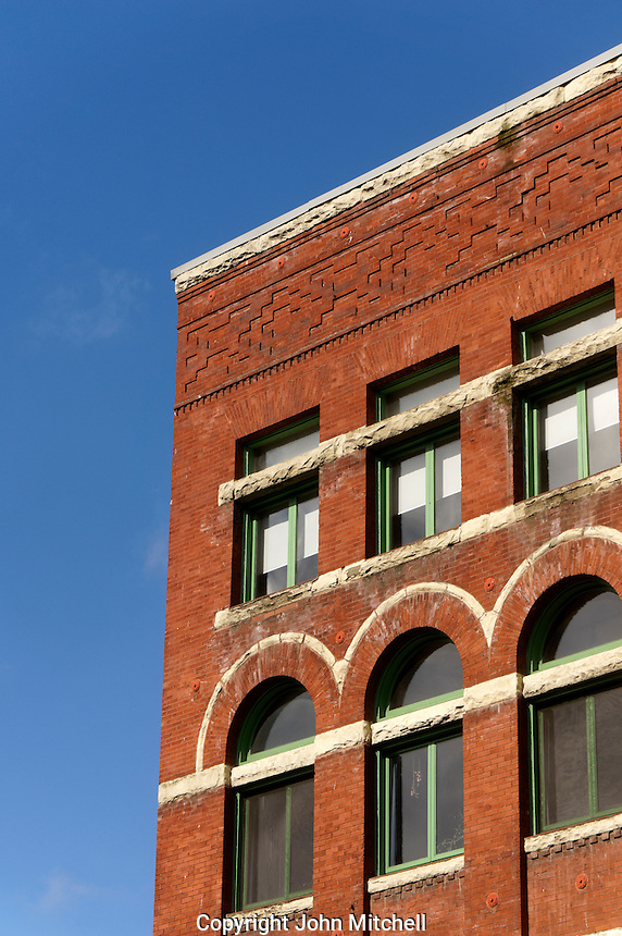 Facade of a Victorian red brick  building in the historical Pioneer Square district of Seattle, Washington, USA