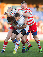 Picture by Allan McKenzie/SWpix.com - 17/04/2015 - Rugby League - Ladbrokes Challenge Cup - Wakefield Trinity Wildcats v Halifax RLFC - Rapid Solicitors Stadium, Wakefield, England - Wakefield's Richard Owen is tackled by Halifax's Ross Divorty & Richard Moore.