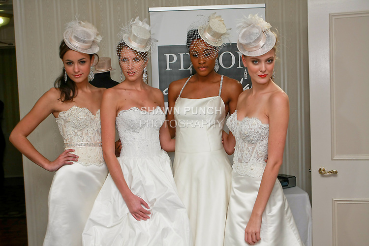 Model pose together in wedding dress by Kimberly Pixton Millar, for the Pixton Couture Bridal Spring 2011 presentation during the WeddingChannel Couture Show, October 18, 2010.