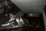 Furry Weekend Atlanta - Convention attendees and hotel guests make their way up an escalator in the Westin...Photo by Raymond McCrea Jones