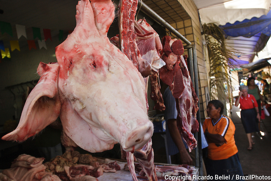 Pork head and meat for sale at open-air market in Penedo, Alagoas State, countryside Brazil.
