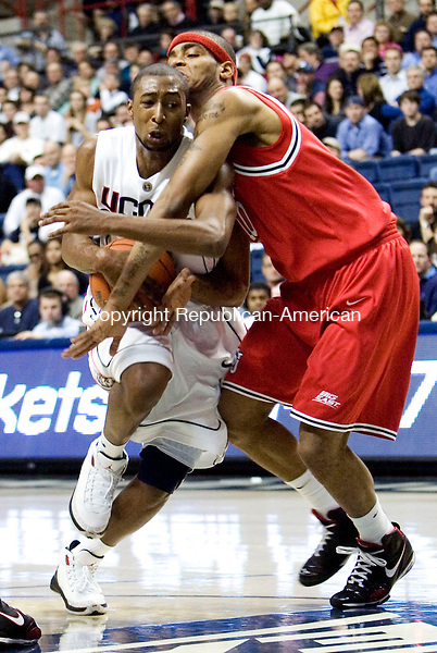 STORRS, CT- 08 JANUARY 2008- 010808JT10-<br /> UConn's A. J. Price is fouled by St. John's D. J. Kennedy during Tuesday's game in Storrs. UConn won 81-65.<br /> Josalee Thrift / Republican-American