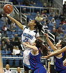Centennial's Tamera Williams fights for a loose ball in a semi-final game at the NIAA 4A State Basketball Championships between Centennial and Reno high schools at Lawlor Events Center in Reno, Nev, on Thursday, Feb. 23, 2012. Reno won 60-41. .Photo by Cathleen Allison