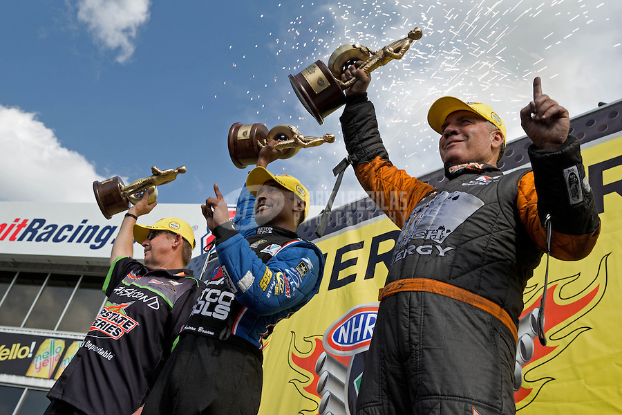 May 11, 2013; Commerce, GA, USA: NHRA champion drivers (R-L) funny car driver Johnny Gray , top fuel dragster driver Antron Brown and pro stock driver Mike Edwards celebrate after winning the Southern Nationals at Atlanta Dragway. Mandatory Credit: Mark J. Rebilas-