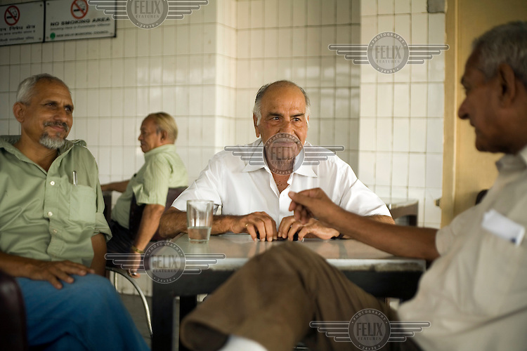 Regular customers sit and talk in the Indian Coffee House, Baba Kharak Singh Marg in New Delhi.