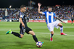 Lucas Vazquez (l) of Real Madrid is challenged by Diego Rico of Deportivo Leganes during their La Liga match between Deportivo Leganes and Real Madrid at the Estadio Municipal Butarque on 05 April 2017 in Madrid, Spain. Photo by Diego Gonzalez Souto / Power Sport Images