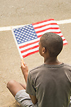 4th of July parade- Madison, CT. African american boy with american flag.