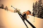 A skier flies above the half pipe at Whistler-Blackcomb Ski Resort, British Columbia, Canada.