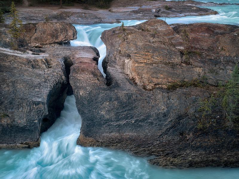Kicking Horse River and Natural Bridge Falls in British Columbia's Canadian Rockies and Yoho National Park.