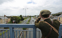Men in World War I gear on a footbridge in Fabian Way, Swansea, south Wales UK. Friday 01 July 2016