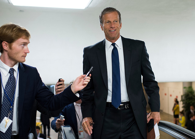 UNITED STATES - JULY 21: Sen. John Thune, R-S. Dak., speaks with a reporter at the Senate subway on Tuesday, July 21, 2015. (Photo By Bill Clark/CQ Roll Call)
