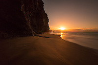 The golden sunset at Kaua'i's Kalalau Beach expresses a zen-like calm and the nurturing spirit of Aloha.