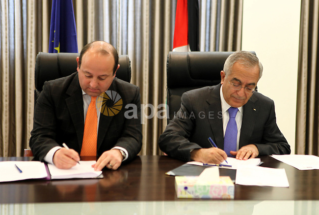 Palestinian prime minister Salam Fayyad, signs a convention with The European Union, in the West Bank City of Ramallah, On Jan. 11, 2012. photo by Mustafa Abu Dayeh