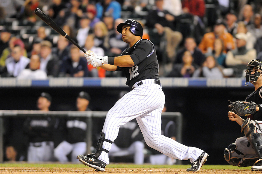 07 SEPTEMBER 2011:   Rockies catcher Wilin Rosario (12) hits his first major league homerun during a regular season game between the Arizona Diamondbacks and and the Colorado Rockies at Coors Field in Denver, Colorado.  The Diamondbacks beat the Rockies 5-3.  *****For Editorial Use Only*****