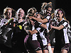 Kelly George #15 of Garden City gets mobbed by teammates after scoring the game-winning goal in the penalty kick phase of the Nassau County varsity girls soccer Class A final against South Side at Cold Spring Harbor High School on Tuesday, Nov. 1, 2016.