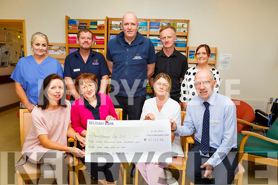 The Chemotherapy Day Unit in UHK recieving €67,737.06 from the Sickly Come Dancing fundraiser.<br /> Seated l-r, Theresa Walsh, Mary Fitzgerald, Cora Walsh and Fergal Grimes.<br /> Back l-r, Margaret Jones, Joseph Diggins, Paul McCarthy, Sean O'Dowd and Teresa O'Carroll.