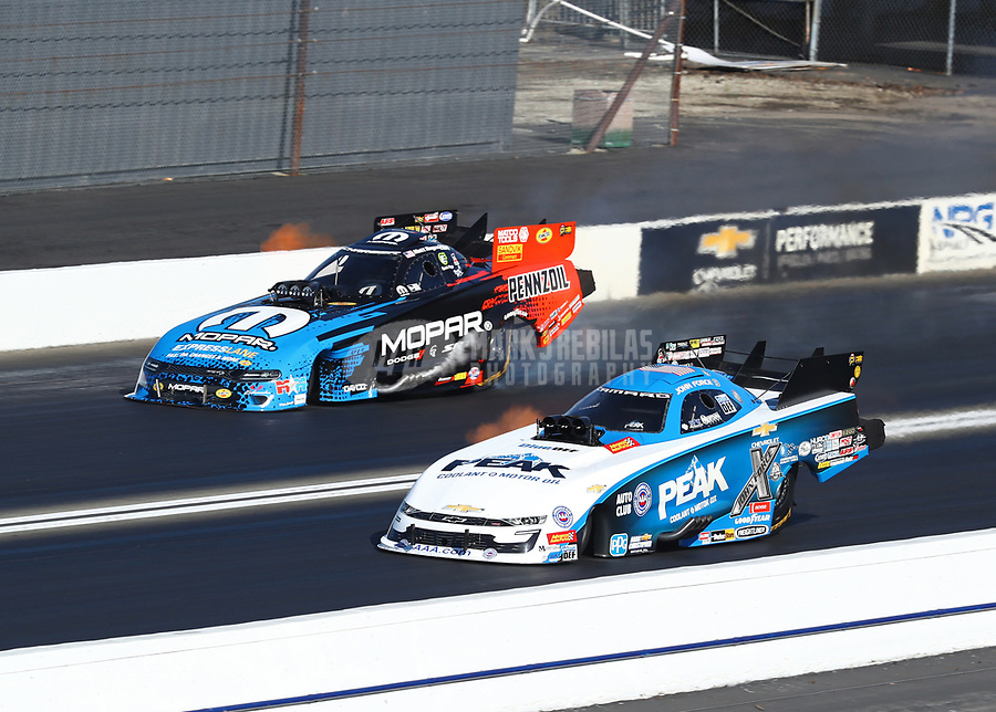 Feb 11, 2019; Pomona, CA, USA; NHRA funny car driver John Force (near) races alongside Matt Hagan during the Winternationals at Auto Club Raceway at Pomona. Mandatory Credit: Mark J. Rebilas-USA TODAY Sports