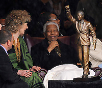 Sculptor Jean Doyle sits with Nelson Mandela, at the unveiling of her bronze statue of Mandela outside the Groot Drakenstein Prison, where Mandela spent his final months before his release in 1990.
